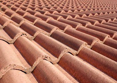 Closeup of a terracotta tile roof.
