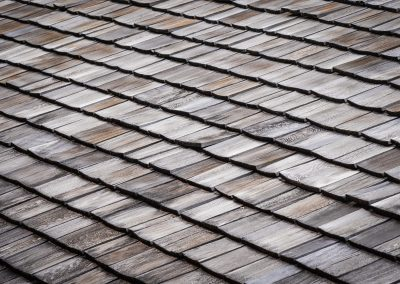 A wooden tile roof.