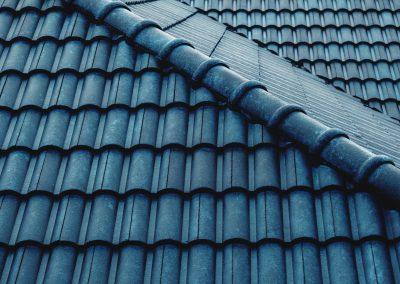 A closeup of a blue tile roof.