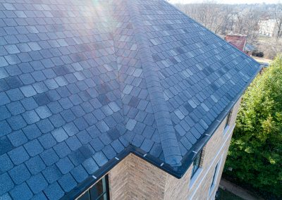 Shingle roofing on a two story home.