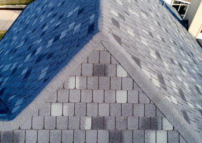 A shingle sloped roof.
