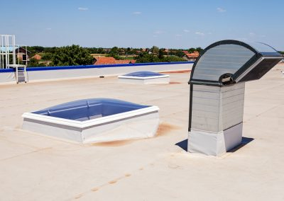A commercial roof with skylights