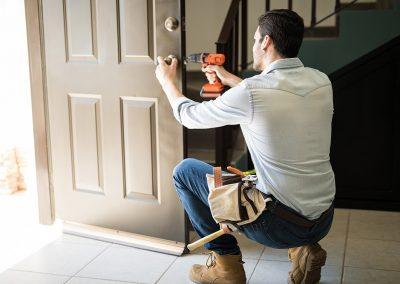 A contractor installing a new door.