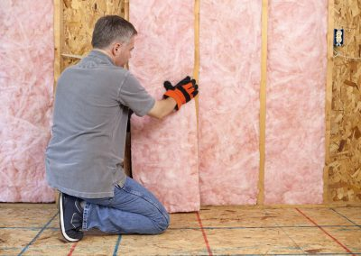 A contractor installing insulation.