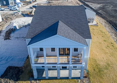 A drone shot of a new shingle roof.