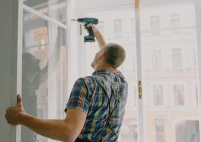 A contractor installing new windows.