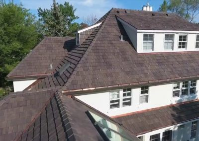 A composite roof tile roof that was installed on a two story home.