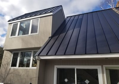 A metal roof with a deep slope on a new build home.