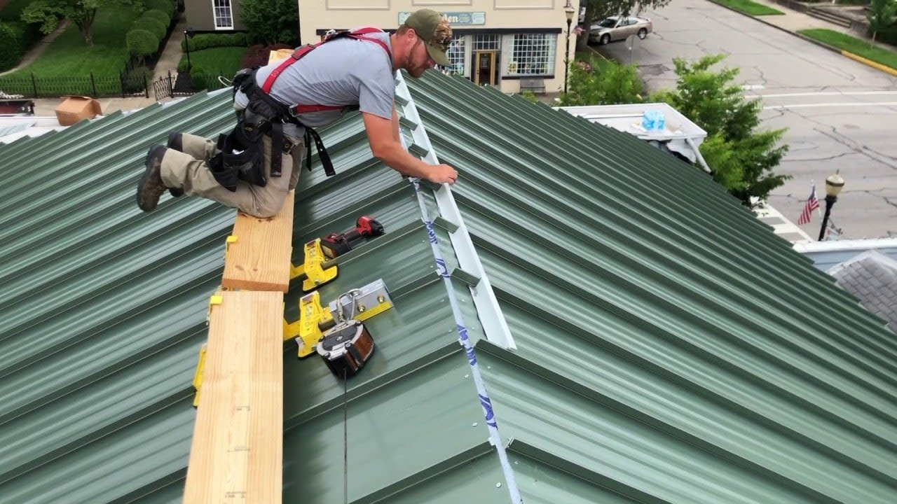 A metal roofing contractor working on a new roof.