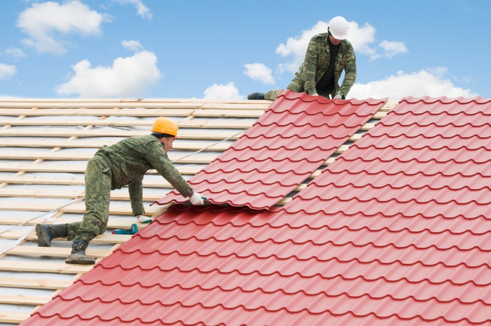 Two contractors from a metal roofing company.