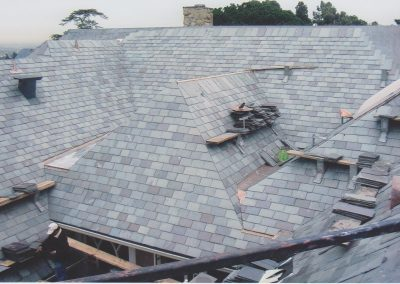 The installation process of a slate roof.