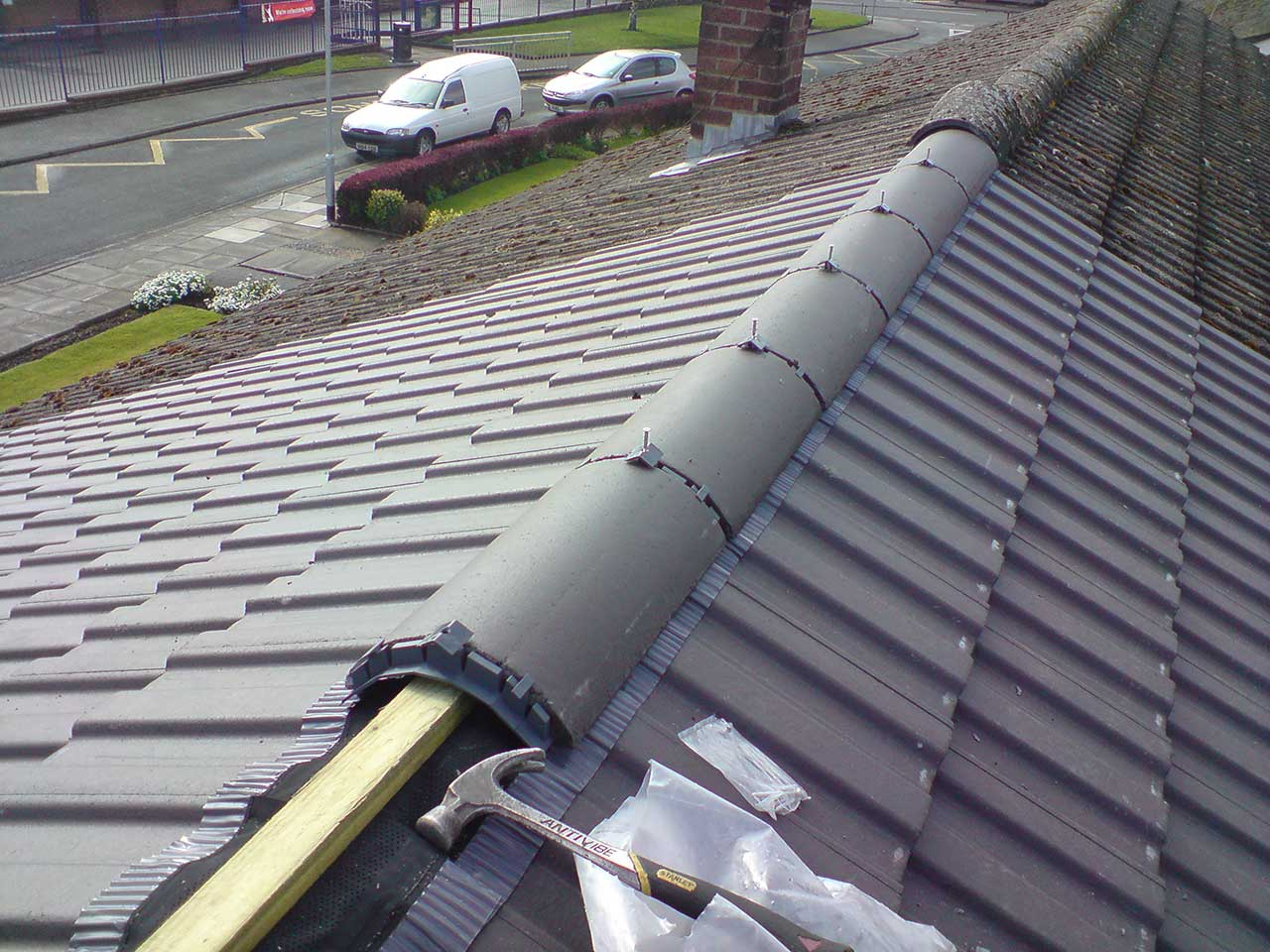 A tile roof being repaired.