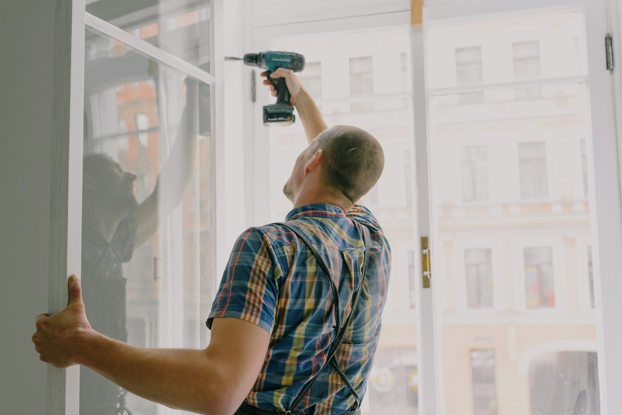Our contractors performing a window installation.